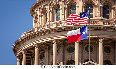 American and Texas Flags Flying at the Texas State Capitol Building in Austin