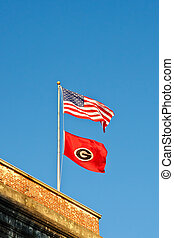 American and University of Georgia flags on Old brick Building
