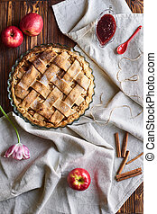 american apple pie and ingredients on wooden background. Top view.