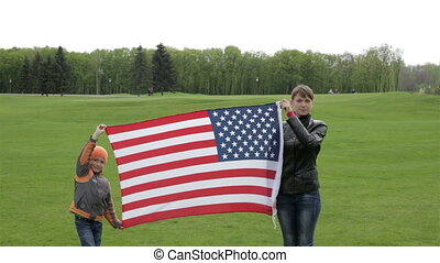 American banner in the hands of the family