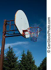American Basketball Hoop against Blue Sky