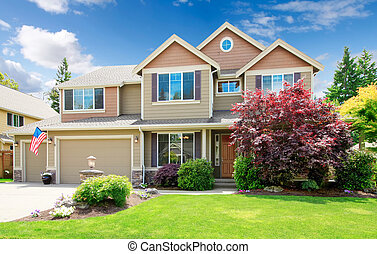 American beige luxury large house front exterior with landscape.
