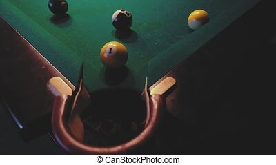 American billiard. Man playing billiard, snooker. Player preparing to shoot, hitting the cue ball. A misfire from close range.