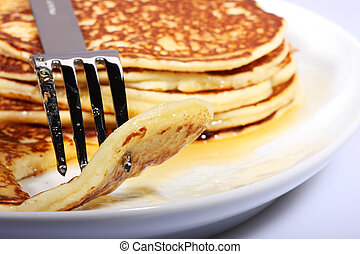 american breakfast - pile of american pancakes with syrup on...