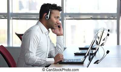 American businessman talking with client online. Spinning on...