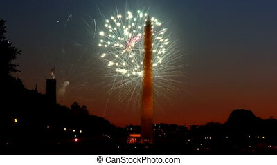 American Celebration Washington Monument at night with holiday festive 4th July fireworks on Independence Day