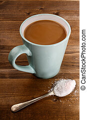 american coffee with milk and sugar on a spoon
