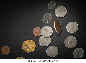 American coin falling on black background