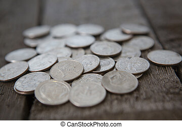 american coins background on wooden table. quarter dollar