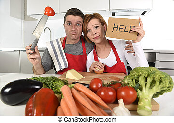 American couple in stress at home kitchen in cooking apron...