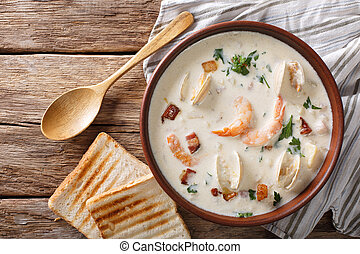 American cuisine: New England clam chowder soup closeup....