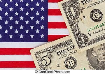 American dollar bills on a Stars and stripes flag