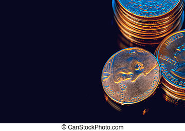 American dollar coins on black background close up