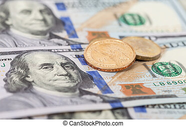 American dollar coins over banknotes close up