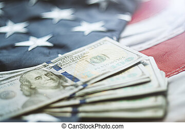 American dollars banknotes on the flag of United States. US dollars background. 100 USD