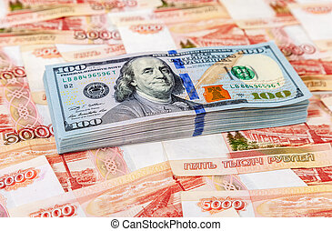 American dollars banknotes over russian roubles