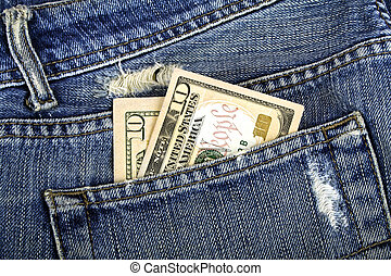American dollars in a blue jeans pocket