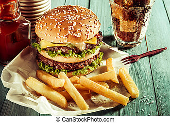 American double cheeseburger with French fries