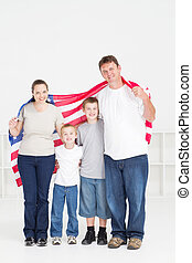 american family of four with flag