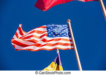 American Flag against blue sky.