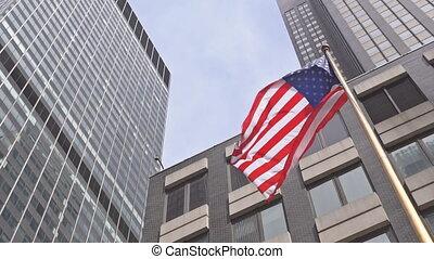 American flag against bright blue sky American flag against...