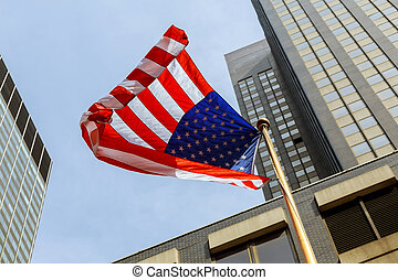 American flag against bright blue sky