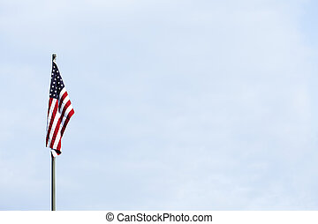 American flag against the blue sky