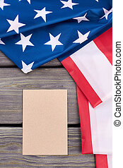American flag and blank paper sheet.
