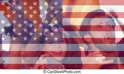American flag and cheerful crowd