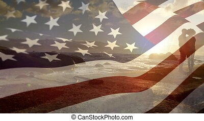 American flag and couple by the beach