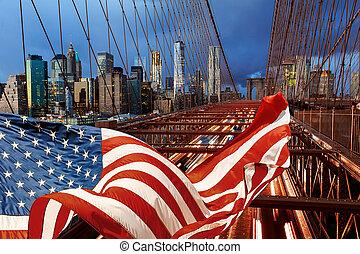 American flag and night with car traffic night Brooklyn Bridge
