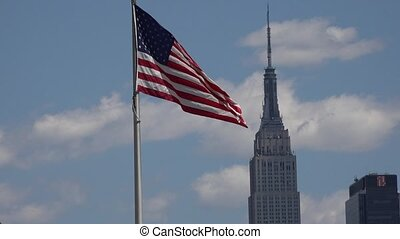American Flag and Office Buildings