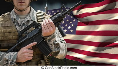 American flag and soldier with weapon