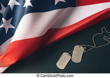 American flag and soldiers tags on wooden background. Veterans Day Concept.