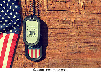 American flag and soldiers tags on wooden background.