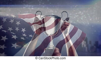 American flag and trophy - Champions hands holding Trophy ...
