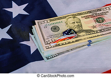 American flag and US dollars and a house key on the apartment architectural plan. Sale and purchase real estate, buying home concept