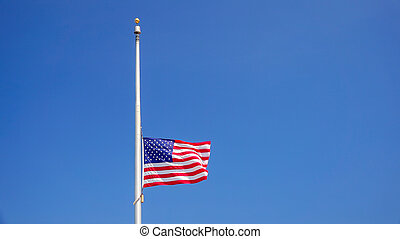 American Flag at Half Mast aka Half Staff Against Clear Blue Sky