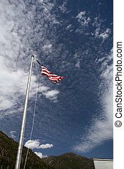 American Flag blowing in the wind.