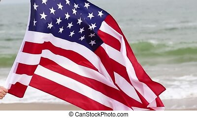 American Flag blowing in the wind on sea background. USA American Flag. Memorial Day, American concept.