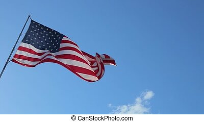 USA American Flag - American Flag blowing in the wind with a...
