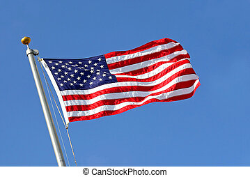 American Flag Blowing in the Wind with Blue Sky
