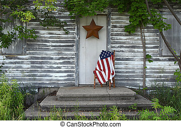 American flag by house door
