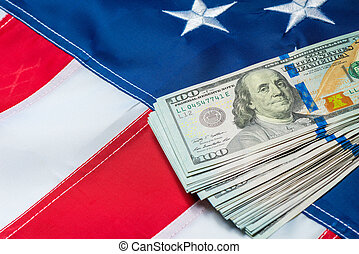 american flag closeup and a bunch of 100 dollar bills