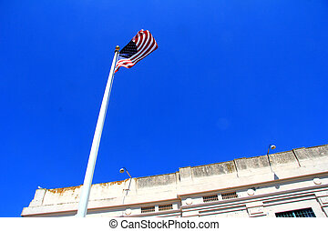 American Flag fluttering in front of building