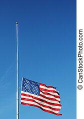 American flag flying at half staff