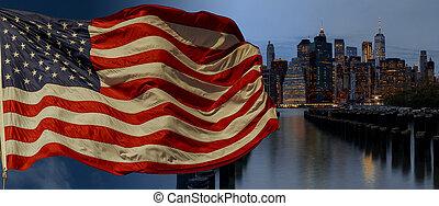 American flag flying the a Skyline New York City manhattan...