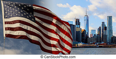 American flag flying the breeze against a blue sky New York,...