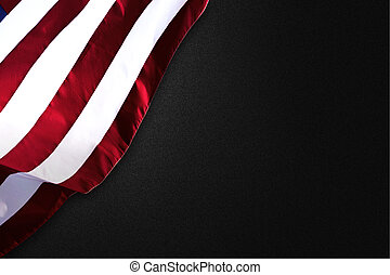 American flag folded on a black background