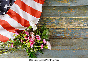 American flag for Memorial Day in Remembrance Veterans Day pink carnation flowers